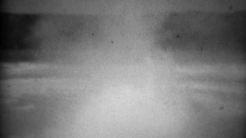1937: Upper Geyser Basin water violently boils bubbles spits and smokes Footage