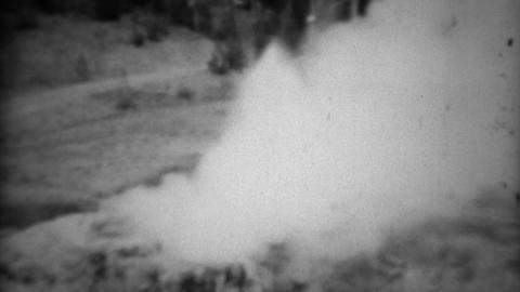1937: Riverside geyser white steam smoke gas blows windy vapors Footage