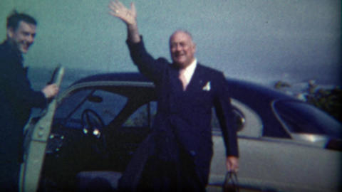 1949: Charming executive and assistant waving goodbye enter car travel Footage