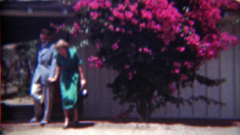 1949: Lovers on holiday getaway women in green fashion dress Footage