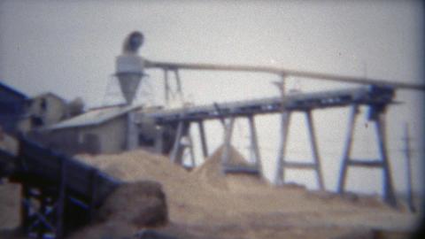 1949: Industrial lumber mill factory wood dust processing smokestack waste Footage
