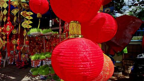 Wind Shakes Large Chinese Lanterns on Street Market in City Footage