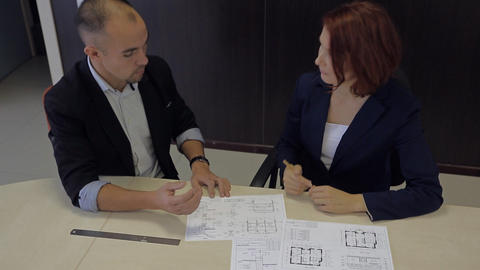 man and woman develop a plan. bank robbers professionals Footage