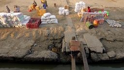 Timelapse of laborers loading a boat on the Irrawaddy,Irrawaddy,Burma Footage