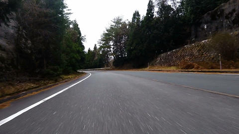 Front bumper view. The car running downhill while shaking Footage