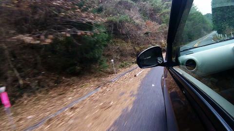 Side window view. The car running a corner at a high speed Footage
