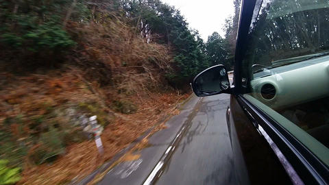 Side window view. The car running on the left hairpin Footage