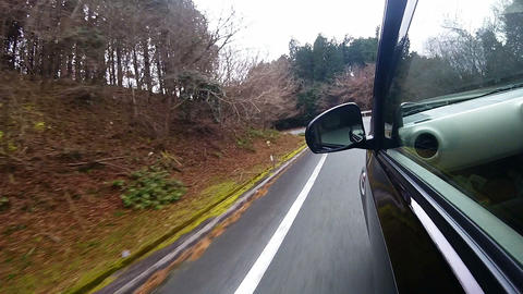 Side window view. The car is running a tight left corner Footage