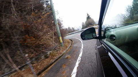 Side window view. The car is running the slow corners of downhill Footage