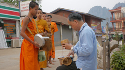 Monks collecting alms,Vang Vieng,Laos Footage