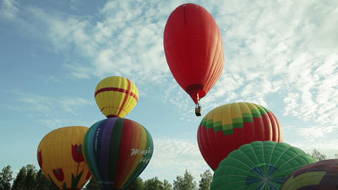 Hot Air Balloons Fly Up In The Sky stock footage
