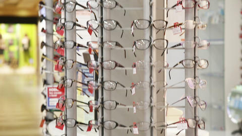 Shelf with modern, beautiful, colored glasses Footage