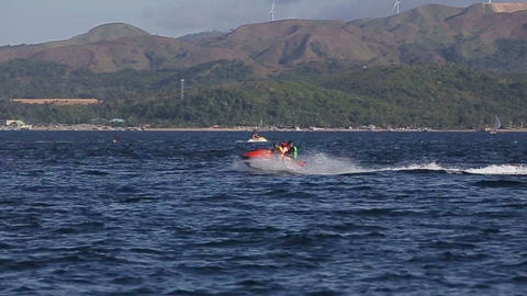 People riding jet ski on blue sea Footage