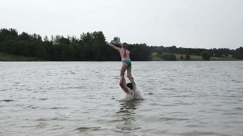 Father and his little daughter having fun on lake Footage