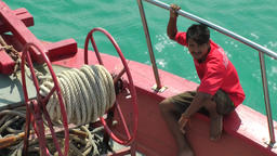 Thailand Ko Samui Island 006 Thai crew member in Bug crowsnest of tender boat Footage