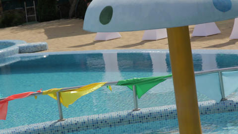 Colored Flags On The Background Of The Pool Footage