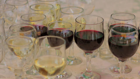 Red And White Wine In Glasses Rack focus shot Footage