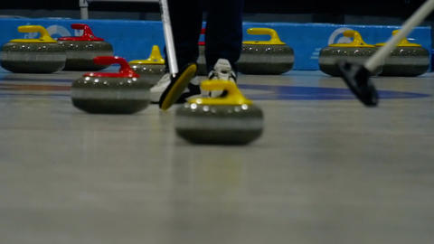 Curling stones on ice Footage