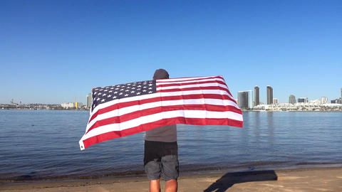 Three videos of man holding american flag in real slow motion Footage