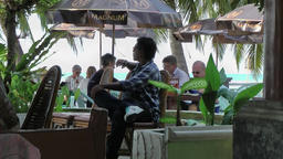 Thailand Ko Samui Island 070 sitting in a beach restaurant Footage