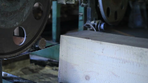Bandsaw sawmill cutting log into dimension lumber Footage