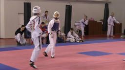 Orenburg, Russia - 27 March 2016: The boys compete in taekwondo Live Action