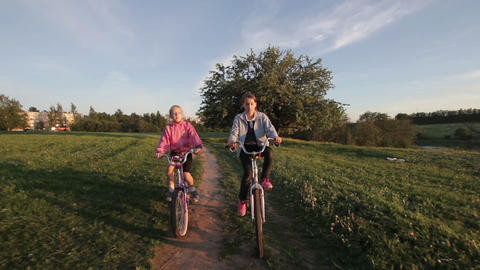 Girls riding bicycle in the countryside Footage