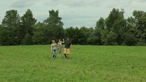 Happy family walking on green meadow Footage