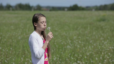 Girl blowing dandelion Footage