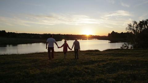 People silhouettes on summer sunset Footage
