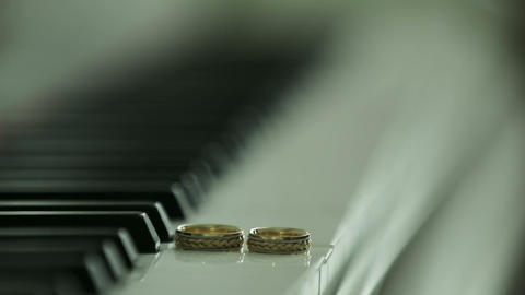 Wedding rings on the piano Footage