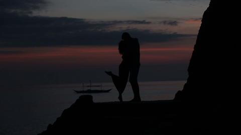 Couple standing on rocks Footage