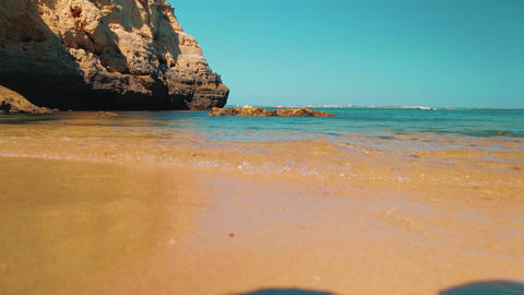 Slider Low Angle Beach Shore Shot in the Algarve, Portugal Footage
