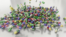 Pills drugs capsules falling on white table counter top slow motion closeup 4K Footage