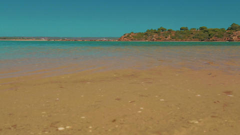 Low Angle Beach Shore Shot Turquoise Water in the Algarve, Portugal Footage