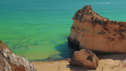 Static Shot of a Rocky Beach with Tourists in the Algarve, Portugal Footage
