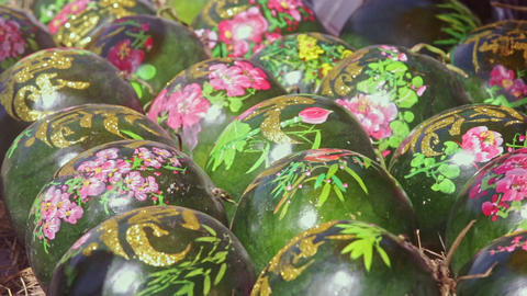 Large Watermelons Decorated with Paintings on Market Footage