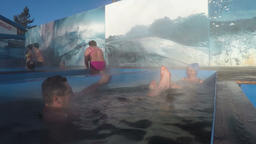 Man and woman relaxing in hot spring pool with natural thermal mineral water Footage