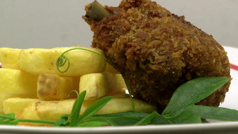 Rotating Fried Chicken & Chips coated in crispy bread crumbs Footage
