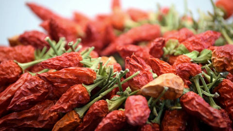 Close up of large bunch of dried chillies rotating slowly Footage