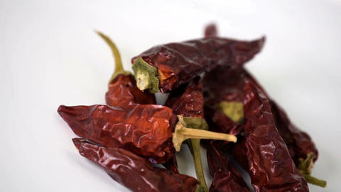 Close up of small bunch of dried chillies rotating slowly Footage