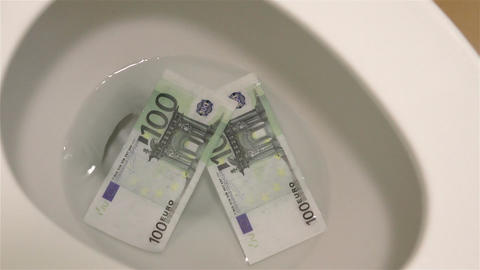 Video of flushing euro banknotes in toilet bowl in real slow motion Footage