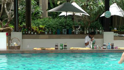 Thailand Pattaya 014 ravindra beach resort, pool bar in water with waiter Footage