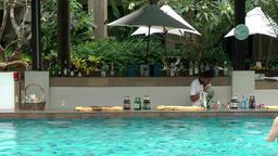 Thailand Pattaya 014 ravindra beach resort, pool bar in water with waiter Footage