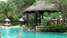 Thailand Pattaya 017 ravindra beach resort, pool bar in water seen at side Footage