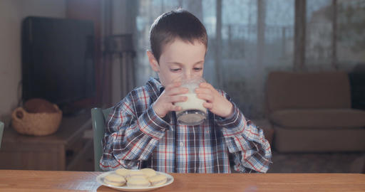 young boy drinking a glass of milk Footage