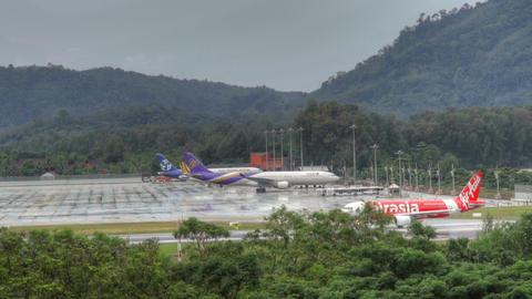 Phuket airport traffic at rain Stock Video Footage