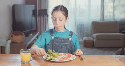 Young eating healthy food and vegetables Live Action