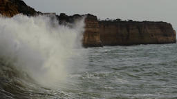 Massive waves splashing at the cliffs, slow mo Footage