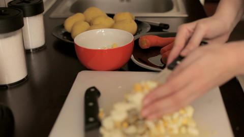 Preparing dinner with cut eggs Footage